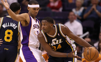 PHOENIX - OCTOBER 12:  C.J. Miles #34 of the Utah Jazz handles the ball during the preseason NBA game against the Phoenix Suns at US Airways Center on October 12, 2010 in Phoenix, Arizona. NOTE TO USER: User expressly acknowledges and agrees that, by down