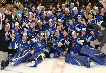 MISSISSAUGA, CANADA - MAY 29: The Saint John Sea Dogs celebrate their win against the Mississauga St. Michael's Majors in the 2011 CHL Mastercard Memorial Cup final on May 29, 2011 at the Hershey Centre in Mississauga, Canada. The Sea Dogs defeated the Ma