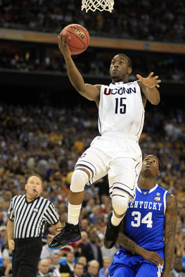 HOUSTON, TX - APRIL 02:  Kemba Walker #15 of the Connecticut Huskies goes to the hoop against the Kentucky Wildcats during the National Semifinal game of the 2011 NCAA Division I Men's Basketball Championship at Reliant Stadium on April 2, 2011 in Houston
