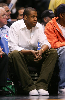 EAST RUTHERFORD, NJ - MAY 14:  Rapper Jay-Z watches the New Jersey Nets take on the Cleveland Cavaliers in Game Four of the Eastern Conference Semifinals during the 2007 NBA Playoffs on May 14, 2007 at the Continental Airlines Arena in the Meadowlands in