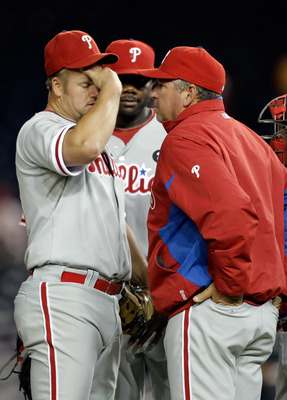 WASHINGTON, DC - APRIL 12:  Starting pitcher Joe Blanton #56 of the Philadelphia Phillies (L) talks with pitching coach Rich Dubee (R) during the fourth inning against the Washington Nationals at Nationals Park on April 12, 2011 in Washington, DC.  (Photo