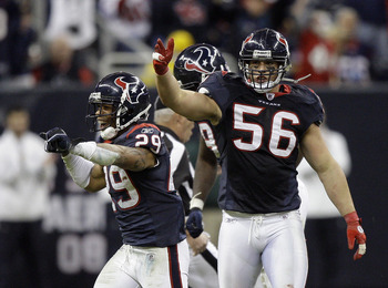HOUSTON - JANUARY 02:  Glover Quin #29 of the Houston Texans and Brian Cushing #56  celebrate after recovering a fumble late in the fourth quarter against the Jacksonville Jaguars at Reliant Stadium on January 2, 2011 in Houston, Texas.  (Photo by Bob Lev