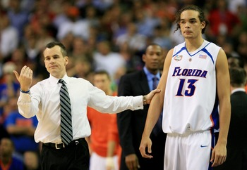Billy Donovan is not as tall as Joakim Noah.