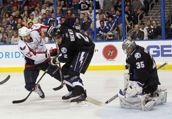 TAMPA, FL - MAY 04: Dwayne Roloson #35 of the Tampa Bay Lightning makes the save on Mike Knuble #22 of the Washington Capitals as Eric Brewer #2 assists him in Game Four of the Eastern Conference Semifinals during the 2011 NHL Stanley Cup Playoffs at the