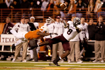 AUSTIN, TX - NOVEMBER 25:  Texas A&M wide receiver Jeff Fuller #8 misses a catch as University of Texas cornerback Aaron Williams #4 defends during the first half at Darrell K. Royal-Texas Memorial Stadium on November 25, 2010 in Austin, Texas. (Photo by