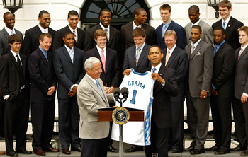 WASHINGTON - MAY 11:  University of North Carolina Men's basketball head coach Roy Williams (L) presents U.S. President Barack Obama with a team jersey at the White House May 11, 2009 in Washington, DC. The North Carolina Tar Heels are the 2009 National C