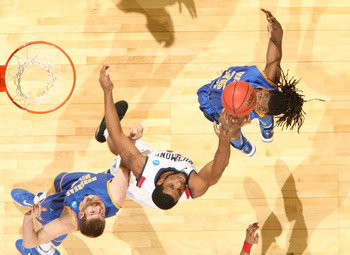 DENVER, CO - MARCH 19:  Kenneth Faried #35 and Drew Kelly #00 of the Morehead State Eagles fight for a rebound against Derrick Williams #34 of the Richmond Spiders during the third round of the 2011 NCAA men's basketball tournament at Pepsi Center on Marc