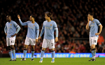 LIVERPOOL, ENGLAND - APRIL 11:  (L-R) Yaya Toure, Joleon Lescott, David Silva and Gareth Barry of Manchester City look dejected during the Barclays Premier League match between Liverpool and Manchester City at Anfield on April 11, 2011 in Liverpool, Engla