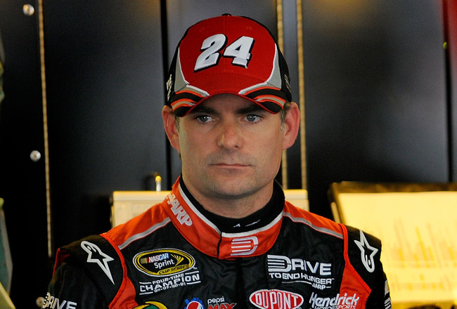 CHARLOTTE, NC - MAY 26:  Jeff Gordon, driver of the #24 Drive to End Hunger/AARP Chevrolet, stands in the garage during practice for the NASCAR Sprint Cup Series Coca-Cola 600 at Charlotte Motor Speedway on May 26, 2011 in Charlotte, North Carolina.  (Pho