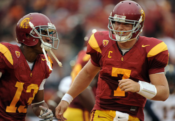 LOS ANGELES, CA - OCTOBER 16:  Matt Barkley #7 and Robert Woods #13 of the USC Trojans celebrate a touchdown for a 28-0 lead over the California Golden Bears during the second quarter at Los Angeles Memorial Coliseum on October 16, 2010 in Los Angeles, Ca