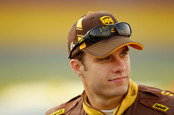 CHARLOTTE, NC - MAY 26:  David Ragan, driver of the #6 UPS Ford, stands next to his car after qualifying for the NASCAR Sprint Cup Series Coca-Cola 600 at Charlotte Motor Speedway on May 26, 2011 in Charlotte, North Carolina.  (Photo by Justin Edmonds/Get