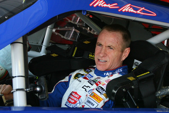 KANSAS CITY, KS - JUNE 03:  Mark Martin, driver of the #5 Farmers Insurance/GoDaddy.com Chevrolet, sits in his car in the garage area during practice for the NASCAR Sprint Cup Series STP 400 at Kansas Speedway on June 3, 2011 in Kansas City, Kansas.  (Pho
