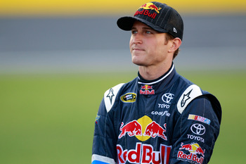 CHARLOTTE, NC - MAY 26:  Kasey Kahne, driver of the #4 Red Bull Toyota, stands on the grid during qualifying for the NASCAR Sprint Cup Series Coca-Cola 600 at Charlotte Motor Speedway on May 26, 2011 in Charlotte, North Carolina.  (Photo by Chris Graythen
