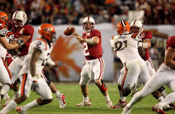 MIAMI, FL - JANUARY 03:  Quarterback Andrew Luck #12 of the Stanford Cardinal throws a pass against the Virginia Tech Hokies during the 2011 Discover Orange Bowl at Sun Life Stadium on January 3, 2011 in Miami, Florida. Stanford won 40-12. (Photo by Stree