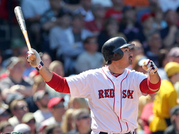 BOSTON, MA - JUNE 5:  Adrian Gonzalez #28 of the Boston Red Sox hits a home run against the Oakland Athletics at Fenway Park on June 5, 2011 in Boston, Massachusetts.  (Photo by Jim Rogash/Getty Images)