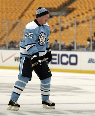 PITTSBURGH, PA - DECEMBER 31:  Larry Murphy #55 of the Pittsburgh Penguins skates against the Washington Capitals during the 2011 NHL Winter Classic Alumni Game on December 31, 2010 at Heinz Field in Pittsburgh, Pennsylvania.  (Photo by Justin K. Aller/Ge