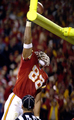 KANSAS CITY, MO - OCTOBER 26:  Tight end Tony Gonzalez #88 of the Kansas City Chiefs dunks the football over the goal post after scoring a touchdown against the Buffalo Bills October 26, 2003 at Arrowhead Stadium in Kansas City, Missouri.  (Photo by Dave