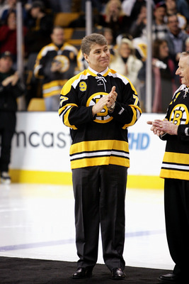 BOSTON - FEBRUARY 13:  Former Boston Bruins player Ray Bourque claps his hands during the ceremony honoring John Bucyk for his 50 years with the Bruins organization before the game against the Edmonton Oilers on February 13, 2007 at TD Banknorth Garden in