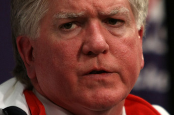 BOSTON - JANUARY 01:  Brian Burke, General Manager of Team USA, is interviewed during a press conference after the Philadelphia Flyers were defeated 2-1 by the Boston Bruins during the 2010 Bridgestone Winter Classic at Fenway Park on January 1, 2010 in B