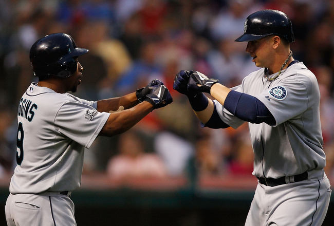 CLEVELAND - MAY 13: Justin Smoak #17 of the Seattle Mariners celebrates with teammate Chone Figgins #9 after hitting a two run home run against the Cleveland Indians during the game on May 13, 2011 at Progressive Field in Cleveland, Ohio.  (Photo by Jared