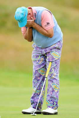 ST ANDREWS, SCOTLAND - JULY 15:  John Daly reacts to a missed birdie putt on the 16th green during the first round of the 139th Open Championship on the Old Course, St Andrews on July 15, 2010 in St Andrews, Scotland.  (Photo by Stuart Franklin/Getty Imag