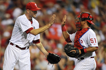 PHILADELPHIA, PA - JUNE 06: Closing pitcher Ryan Madson #46 and Carlos Ruiz #51 of the Philadelphia Phillies high-five after the game against the Los Angeles Dodgers at Citizens Bank Park on June 6, 2011 in Philadelphia, Pennsylvania. The Phillies won 3-1