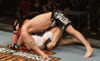 Darren Elkins securing a takedown