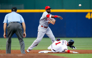 ATLANTA, GA - MAY 27:  Brandon Phillips #4 of the Cincinnati Reds turns a double play over Jordan Schafer #1 of the Atlanta Braves in the first inning at Turner Field on May 27, 2011 in Atlanta, Georgia.  (Photo by Kevin C. Cox/Getty Images)