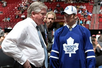 MONTREAL, QC - JUNE 27:  Kenny Ryan speaks to General Manager Brian Burke of the Toronto Maple Leafs organization after he was drafted by the Leafs in the second round during the 2009 NHL Entry Draft at the Bell Centre on June 27, 2009 in Montreal, Quebec