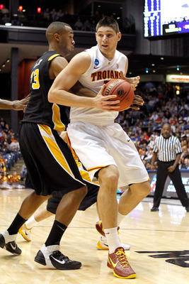 DAYTON, OH - MARCH 16: Nikola Vucevic #5 of the USC Trojans handles the ball against D.J. Haley #33 of the Virginia Commonwealth Rams during the first round of the 2011 NCAA men's basketball tournament at UD Arena on March 16, 2011 in Dayton, Ohio.  (Phot