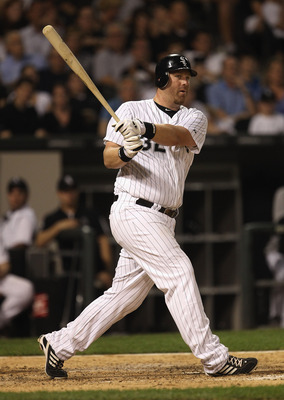 CHICAGO, IL - JUNE 06:  Adam Dunn #32 of the Chicago White Sox hits a foul ball against the Seattle Mariners at U.S. Cellular Field on June 6, 2011 in Chicago, Illinois. The White Sox defeated the Mariners 3-1.  (Photo by Jonathan Daniel/Getty Images)