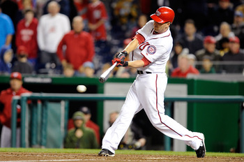 WASHINGTON, DC - APRIL 15:  Adam LaRoche #25 of the Washington Nationals drives in the winning run in the tenth inning against the Milwaukee Brewers at Nationals Park on April 15, 2011 in Washington, DC. The Nationals won the game 4-3. All players, coache