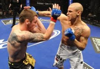 Dustin Poirier exchanging in the stand-up