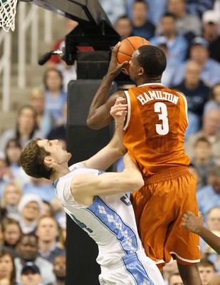GREENSBORO, NC - DECEMBER 18:  Tyler Zeller #44 of the North Carolina Tar Heels takes a charge from Jordan Hamilton #3 of the Texas Longhorns at Greensboro Coliseum on December 18, 2010 in Greensboro, North Carolina.  (Photo by Kevin C. Cox/Getty Images)