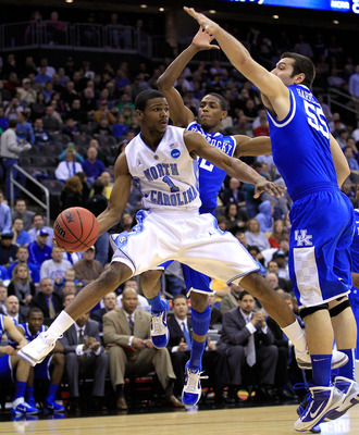 NEWARK, NJ - MARCH 27:  Dexter Strickland #1 of the North Carolina Tar Heels passes the ball against Josh Harrellson #55 and Brandon Knight #12 of the Kentucky Wildcats during the first half of the east regional final of the 2011 NCAA men's basketball tou