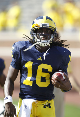 ANN ARBOR, MI - OCTOBER 09:  Denard Robinson #16 of the Michigan Wolverines warms up prior to the start of the game against the Michigan State Spartans on October 9, 2010 at Michigan Stadium in Ann Arbor, Michigan. The Michigan State Spartans defeated the