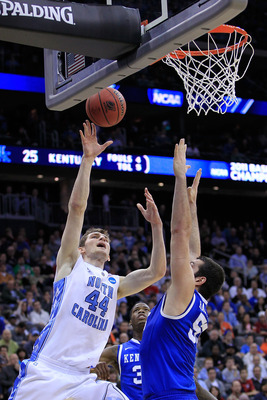 NEWARK, NJ - MARCH 27:  Tyler Zeller #44 of the North Carolina Tar Heels in action against Josh Harrellson #55 of the Kentucky Wildcats during the east regional final of the 2011 NCAA men's basketball tournament at Prudential Center on March 27, 2011 in N