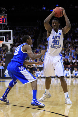 NEWARK, NJ - MARCH 27:  Harrison Barnes #40 of the North Carolina Tar Heels in action against Brandon Knight #12 of the Kentucky Wildcats during the east regional final of the 2011 NCAA men's basketball tournament at Prudential Center on March 27, 2011 in