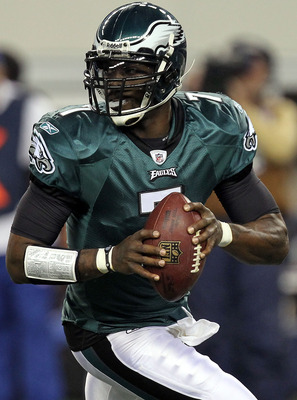 ARLINGTON, TX - DECEMBER 12:  Quarterback Michael Vick #7 of the Philadelphia Eagles drops back to pass against the Dallas Cowboys at Cowboys Stadium on December 12, 2010 in Arlington, Texas.  (Photo by Ronald Martinez/Getty Images)