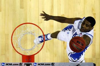 CHARLOTTE, NC - MARCH 18:  Kyrie Irving #1 of the Duke Blue Devils lays the ball up against the Hampton Pirates during the second round of the 2011 NCAA men's basketball tournament at Time Warner Cable Arena on March 18, 2011 in Charlotte, North Carolina.