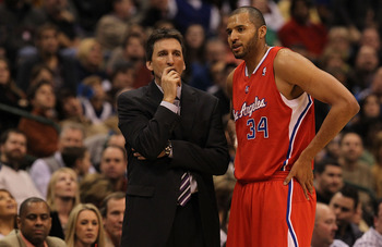 DALLAS, TX - JANUARY 25:  Head coach Vinny Del Negro and Brian Cook #34 of the Los Angeles Clippers at American Airlines Center on January 25, 2011 in Dallas, Texas.  NOTE TO USER: User expressly acknowledges and agrees that, by downloading and or using t