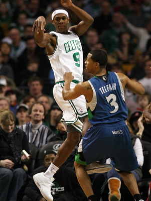 BOSTON - FEBRUARY 01:  Rajon Rondo #9 of the Boston Celtics passes the ball as Sebastian Telfair #3 of Minnesota Timberwolves defends on February 1, 2009 at TD Banknorth Garden in Boston, Massachusetts. The Celtics defeated the Timberwolves 109-101. NOTE
