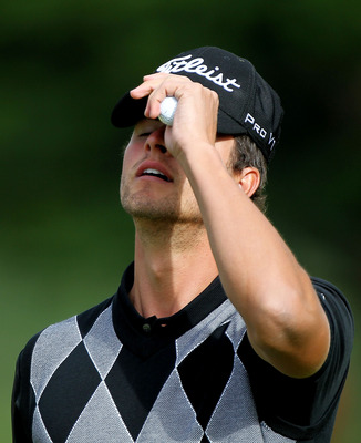 PEBBLE BEACH, CA - JUNE 17:  Adam Scott of Australia reacts to missing a putt on the second hole during the first round of the 110th U.S. Open at Pebble Beach Golf Links on June 17, 2010 in Pebble Beach, California.  (Photo by Donald Miralle/Getty Images)
