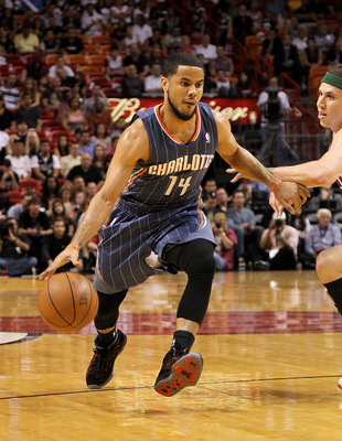 MIAMI, FL - APRIL 08:  D.J. Augustin #14 of the Charlotte Bobcats drives to the lane during a game against the Miami Heat at American Airlines Arena on April 8, 2011 in Miami, Florida. NOTE TO USER: User expressly acknowledges and agrees that, by download