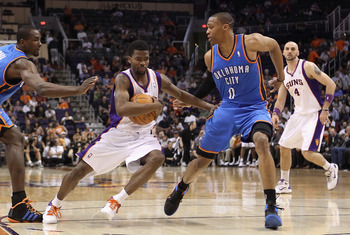 PHOENIX, AZ - MARCH 30:  Aaron Brooks #0 of the Phoenix Suns drives the ball past Russell Westbrook #0 of the Oklahoma City Thunder during the NBA game at US Airways Center on March 30, 2011 in Phoenix, Arizona.  The Thunder defeated the Suns 116-98. NOTE