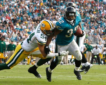 JACKSONVILLE, FL - DECEMBER 14:  Maurice Jones-Drew #32 of the Jacksonville Jaguars breaks the tackle of Brandon Chillar #54 of the Green Bay Packers during the game at Jacksonville Municipal stadium on December 14, 2008 in Jacksonville, Florida.  (Photo