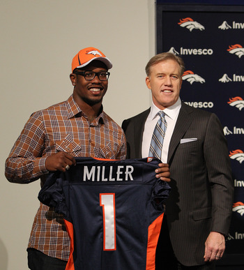 ENGLEWOOD, CO - APRIL 29:  Von Miller of the Denver Broncos is presented to the media for the first time with vice president of football operations John Elway at Dove Valley on April 29, 2011 in Englewood, Colorado. Miller, a projected outside linebacker