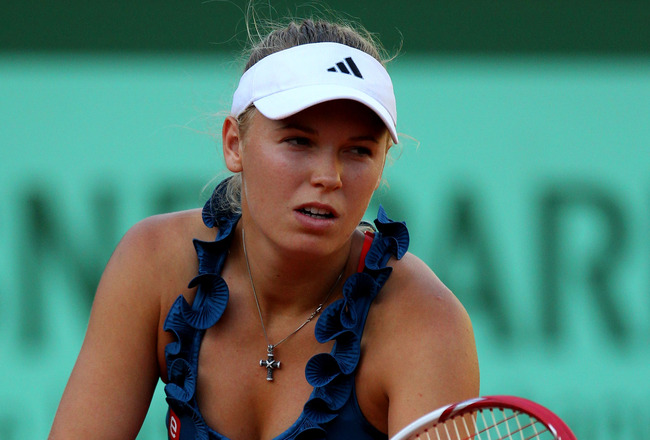 PARIS, FRANCE - MAY 23:  Caroline Wozniacki of Denmark serves during the women's singles round one match between Caroline Wozniacki of Denmark and Kimiko Date-Krumm of Japan on day two of the French Open at Roland Garros on May 23, 2011 in Paris, France.