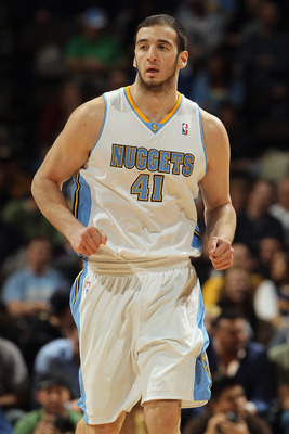 DENVER, CO - MARCH 02:  Kosta Koufos #41 of the Denver Nuggets heads up court against the Charlotte Bobcats at the Pepsi Center on March 2, 2011 in Denver, Colorado. The Nuggets defeated the Bobcats 120-80.NOTE TO USER: User expressly acknowledges and agr