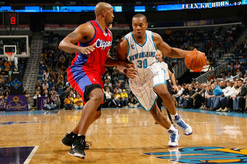 NEW ORLEANS - JANUARY 13:  David West #30  of the New Orleans Hornets drives the ball around Brian Skinner #8 of the Los Angeles Clippers at the New Orleans Arena on January 13, 2010 in New Orleans, Louisiana.  The Hornets defeated the Clippers 108-94.  N
